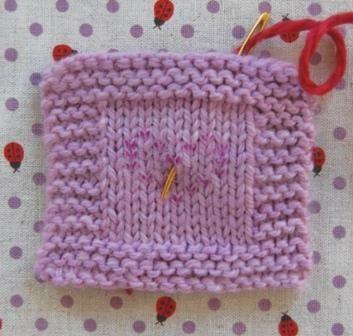 Вышивка на вязаном изделии